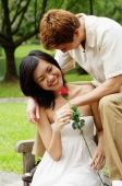 Couple on park bench, woman holding a rose - Alex Microstock02