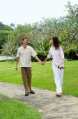 Couple walking hand in hand in park - Alex Microstock02
