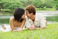 Couple lying on grass, face to face - Alex Microstock02