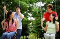 Women on swings, men standing behind them - Alex Microstock02