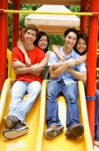 Young adults in playground, smiling at camera, portrait - Alex Microstock02
