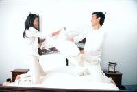 Couple pillow fighting - Alex Microstock02