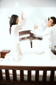 Couple holding pillows, fighting - Alex Microstock02