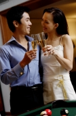 Couple standing side by side, toasting with champagne glasses - Alex Microstock02