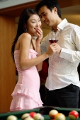 Couple standing side by side, man whispering in womans ear - Alex Microstock02