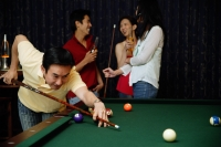 Man playing snooker, people in the background - Alex Microstock02