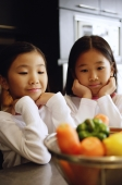 Two girls looking at a bowl of vegetables - Alex Microstock02