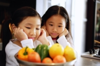 Children staring at a bowl of vegetables - Alex Microstock02