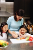 Mother with two daughters in kitchen - Alex Microstock02