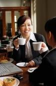 Two businesswomen at cafe, drinking coffee - Alex Mares-Manton