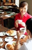Two women having tea at cafe - Alex Microstock02
