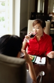 Two women at restaurant, drinking wine - Alex Microstock02