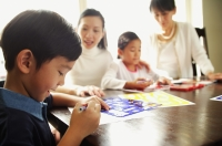 Children drawing, mother and grandmother watching - Alex Microstock02