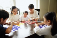 Children drawing, mother and grandmother next to them, watching - Alex Microstock02