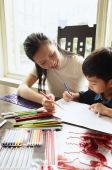 Mother sitting with son, drawing with colour pencils - Alex Microstock02