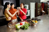 Women in kitchen, toasting - Alex Microstock02