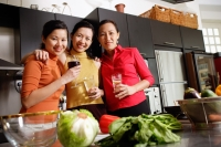 Women in kitchen, standing side by side, smiling at camera - Alex Microstock02
