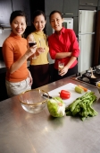 Women in kitchen, smiling at camera - Alex Microstock02