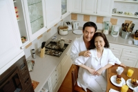 Couple in kitchen, smiling at camera, high angle view - Alex Microstock02