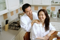 Couple in kitchen, man massaging womans shoulder - Alex Microstock02