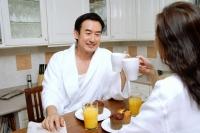Couple sitting in kitchen, having breakfast - Alex Microstock02