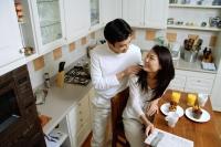 Couple in kitchen, man massaging womans shoulder - Alex Microstock02