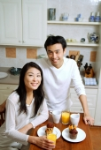 Couple having breakfast, smiling at camera - Alex Microstock02
