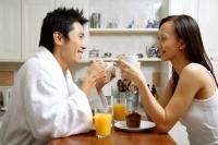 Couple in kitchen, having breakfast - Alex Microstock02