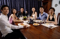 Adults sitting around table at dinner party - Alex Microstock02