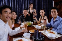 Couples at a dinner party, smiling at camera - Alex Microstock02
