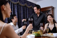 Couples having dinner party at home, man pouring wine for man - Alex Microstock02