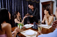Party at home, women accepting birthday cake from man - Alex Microstock02
