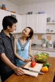 Couple in kitchen, smiling at each other - Alex Microstock02