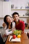 Couple side by side in kitchen, smiling at camera - Alex Microstock02