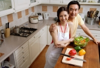 Couple in kitchen, smiling at camera, portrait - Alex Microstock02