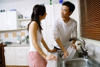 Couple in kitchen, washing dishes - Alex Microstock02