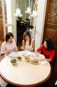 Three women having a meal at restaurant - Alex Microstock02