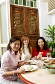 Women having a meal at restaurant, looking at camera - Alex Microstock02