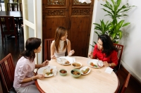 Three women having a meal at restaurant, high angle view - Alex Microstock02