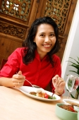 Woman having a meal, smiling at camera - Alex Microstock02