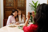 Women taking picture of friends - Alex Microstock02