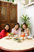 Three women looking at camera, smiling - Alex Microstock02