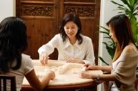 Three women playing mahjong together - Alex Microstock02