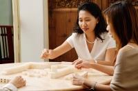 Friends playing mahjong - Alex Microstock02
