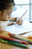 Young girl drawing, resting chin on arm - Alex Microstock02