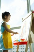 Young girl standing in front of easel, painting - Alex Microstock02