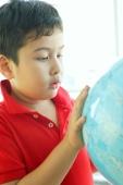 Boy looking at globe - Alex Microstock02