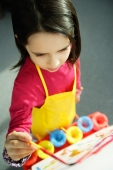 Young girl painting, high angle view - Alex Microstock02