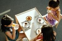 Three girls having a tea party - Alex Microstock02