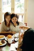 Women posing for photograph, smiling - Alex Microstock02